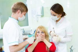 woman afraid of dentist