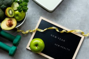 "board that says ""new year, new health"""