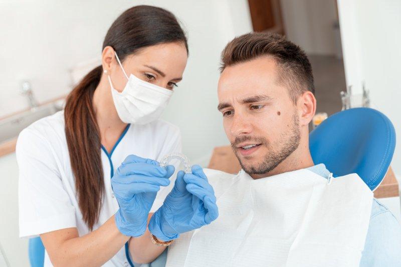 Man getting Invisalign at dentist